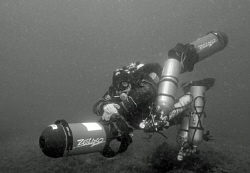 Diver with stages and 2 scooters by Andy Kutsch