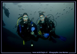 My wife Caroline (on the right) with Sophie under the ice... by Michel Lonfat