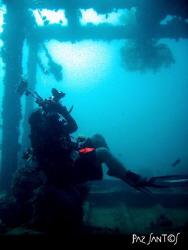 My buddy Alberto under the Darilaot Wreck. by Paz Maria De Vera-Santos