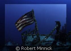 Flag on the Spiegel Grove Key Largo, Fl. by Robert Minnick