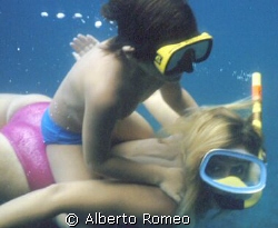 MOTHER AND CHILD  IN FUNNY SKINDIVING.