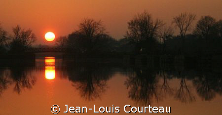 """Diving Sun""     ...at the end of a diving day. by Jean-Louis Courteau"