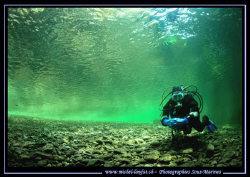 My wife at the entrance of a Dive Site in the River Mal-M... by Michel Lonfat