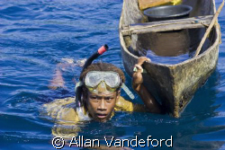 Young future-diver with canoe in tow.  The image was take... by Allan Vandeford
