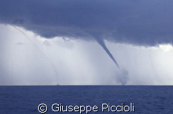 Twin twisters by Giuseppe Piccioli