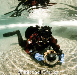 Diver with camera at the ice entry hole in Morrison's qua... by Michael Grebler