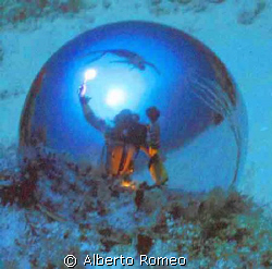 SELF PORTRAIT WITH DIVER IN THE SURFACE AND SUNLIGHT REFL... by Alberto Romeo