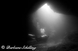 A diver leaving a cave by Barbara Schilling