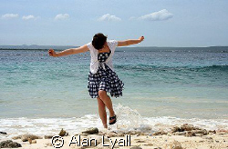 Carefree in Bonaire - my daughter getting her feet wet at... by Alan Lyall