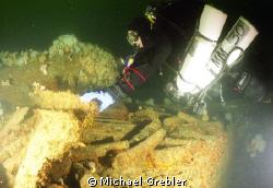 At 165 feet, a Nova Scotia tech diver examines a portion ... by Michael Grebler