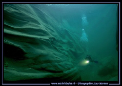 My wife Caroline - diving along the beautiful rocky forma... by Michel Lonfat