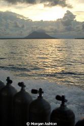 The long boat ride home. Bunaken National Marine Park. Ta... by Morgan Ashton
