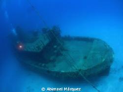 Evelio Pina at Butler Bay wrecks Site. by Abimael Márquez