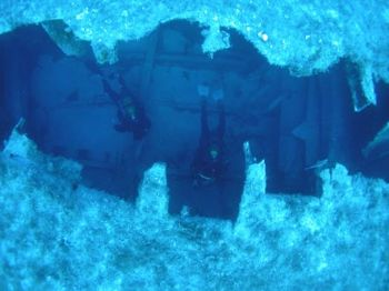 TAKEN IN MALTA ON THE SS.UM AL FARUDE. DIVERS INSIDE THE ... by Kevin Hunkin