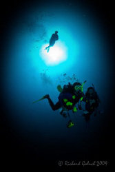 Divers descending-Roatan 2009 by Richard Goluch
