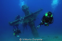 "Divers on the wreck of ""Laura C"" by Vittorio Durante"