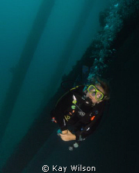 Diver, under the pier. DX1G with wide angle lens, YS110a... by Kay Wilson