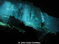 """Blue Fins""   A group of tourist divers prepares to explo... by Jean-Louis Courteau"
