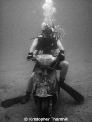 A friend on a recently dumped scooter off Okinawa. Canon ... by Kristopher Thornhill