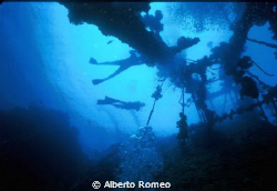 two divers exploring the wreck of Umbria in Sudan Red Sea... by Alberto Romeo