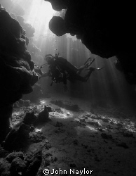 diver in cave by John Naylor