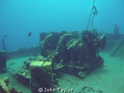 Wide-angle shot of the huge anchor winch on the bow of th... by John Taylor