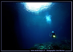 My wife Caroline diving Qawra Point in Malta. A beautiful... by Michel Lonfat