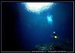My wife Caroline diving Qawra Point in Malta. A beautiful... by Michel Lonfat