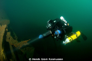 Diver on the WWII wreck UJ-173 Submarinehunter by Henrik Gram Rasmussen