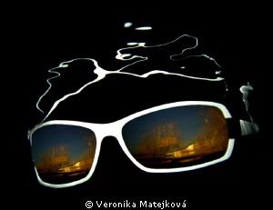 Sunglasses under water by Veronika Matějková