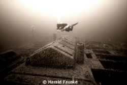 Diving is great  :)     Diver over skylights , ww2 wreck,... by Harald Fauske