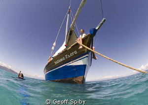 snorkelling from a dhow in Madagascar by Geoff Spiby