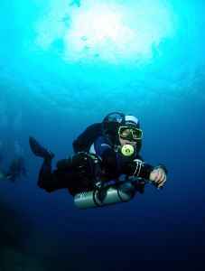 Diver on his way to deco by Andy Kutsch