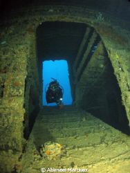 Evelio penetrating the wreck, Wit shoal, St. Thomas. by Abimael Márquez