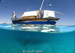 snorkelling under the dhow by Geoff Spiby