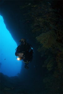 Buddy Ray exploring one of Estartit caves by Sven Tramaux