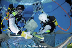 Astronaut traning at ESAs Neutral Buoyancy Facility in Co... by Christian Skauge