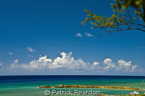 Looking North from Conch Point, Grand Cayman, at mid-day.... by Patrick Reardon