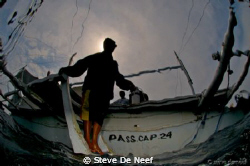 The boatman looking a bit spooky after the dive... by Steve De Neef