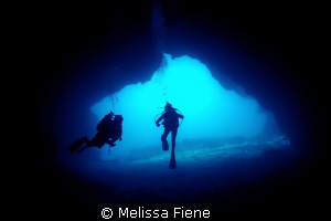 Image of divers in a cave, Vava'u Tonga. by Melissa Fiene