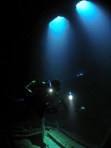 My friend Carlos inside the wreck of the WIT Shoal.  No s... by Juan Torres
