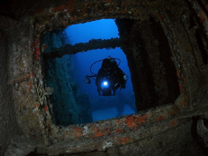 A diver entering the Chikuzen, on of BVI`s best wrecks. by Juan Torres