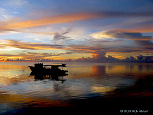 """At the End of the Day"" Sunset across Bunaken taken with ... by Debi Henshaw"