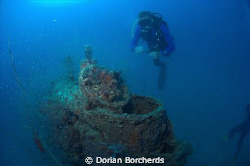 Diver next to a Japanese 2 Man Mini Sub conning tower.Use... by Dorian Borcherds