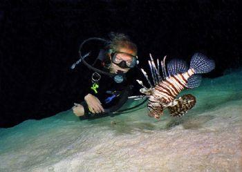 Jane and a Lionfish   Red Sea Nikonos V by Nicolai Sosnowski