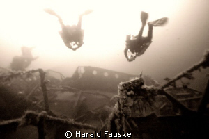 tech-divers behind the superstructure of ww2 wreck radbod... by Harald Fauske