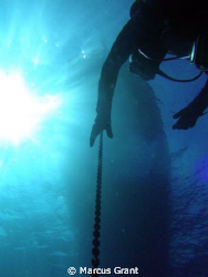 A Diver seting up for his stop after a dive on the P31 wr... by Marcus Grant