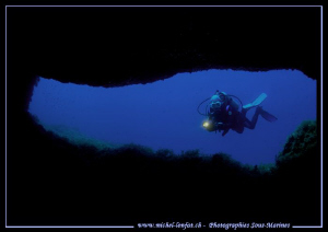 Caroline at the Entrance of a cave in Gozo Malta... Que d... by Michel Lonfat