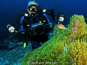 Jeff and anemone fish at Komodo.  G9/DS160s/Wide Angle Lens. by Richard Witmer