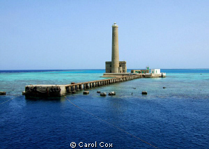 This is the Sanganeab Lighthouse in Sudan's Red Sea.  We ... by Carol Cox